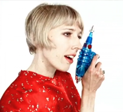 A photo of a woman with a laser gun on a white background
